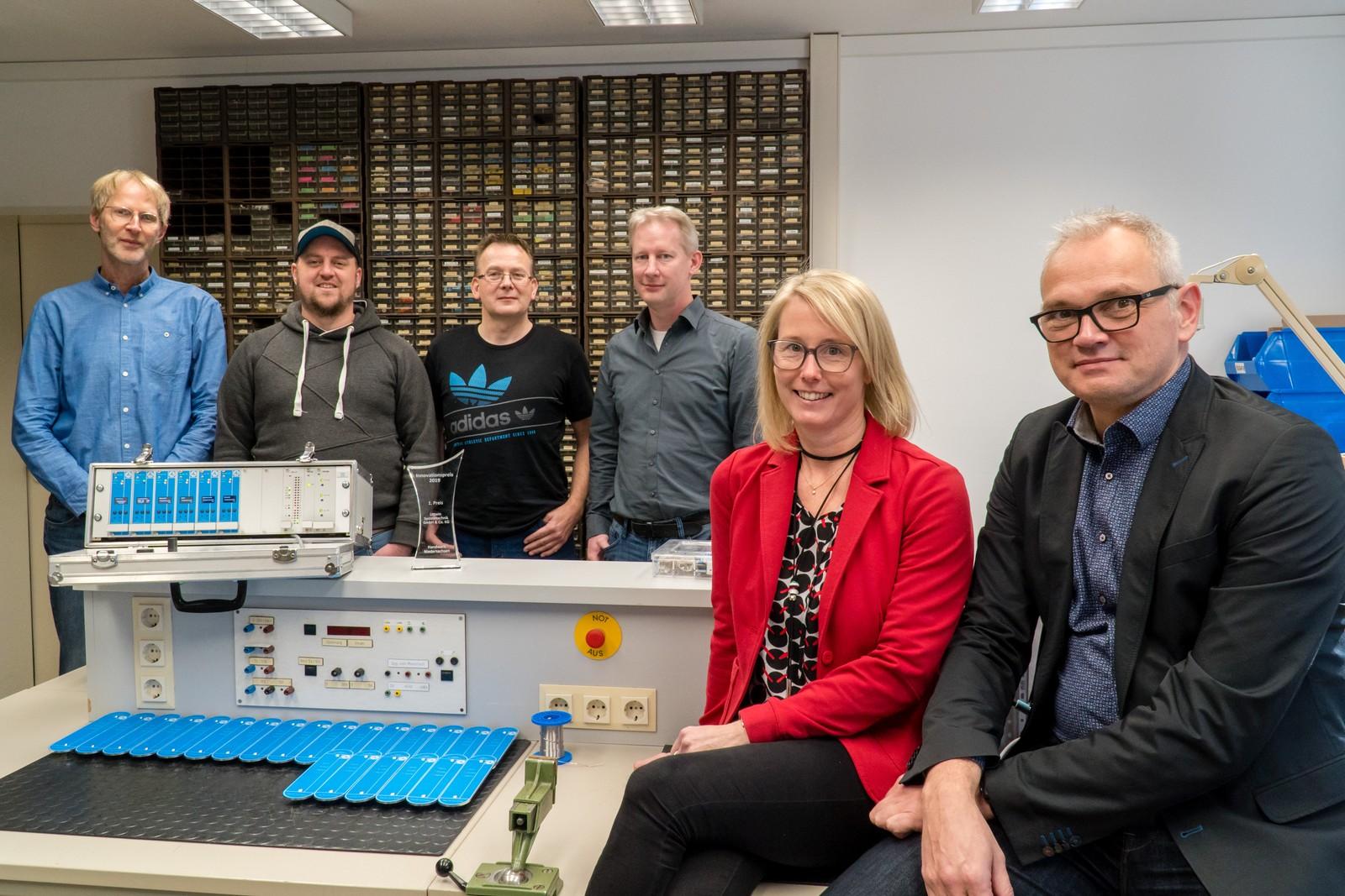 Torsten Janssen, Andreas Tholen, Michael Kersting und Kai Schmidt neben dem Unternehmerpaar Imke und Jörg Littwin.